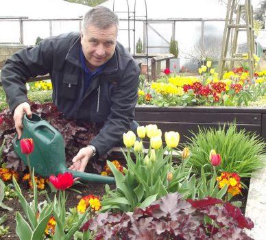Park ranger Steve Berry at one of the flower beds in the community garden.