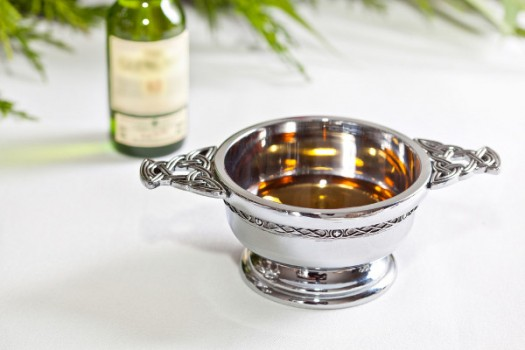The Quaich, or Loving Cup, was first used at a wedding in 1589 by King James VI offering wine to his bride Anne. It symbolises trust and nurturing.