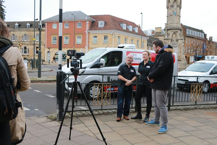 Reg and Alison Howe, of Reg's Café being filmed by Banbury Cross,