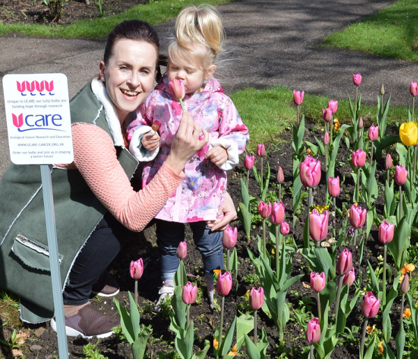 Park user Aneta Whittle with her daughter Lenna, 2, admire the tulips.