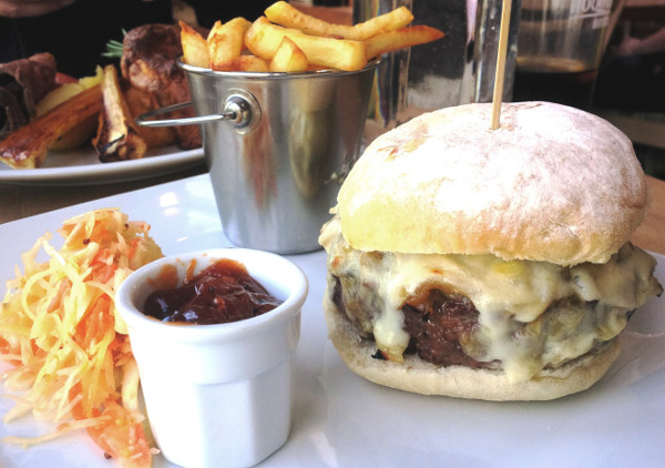 Carpenters Burger with cheese sauce, onions, tomato jam & double cooked skinny chips