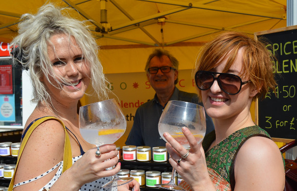Charlie Knight (left) and Pippa Richards enjoy as taster at the Go Spice stall.