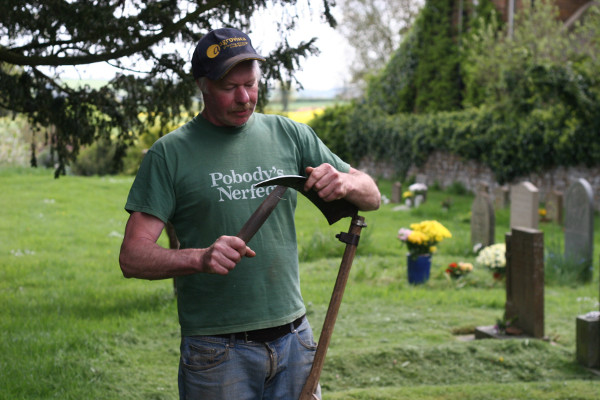 Christopher Hawtin and his forefathers have been strewing the grass by hand since the 1800s