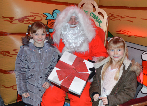 Faith and Sophia in Santa's grotto