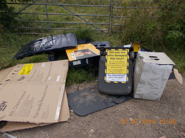 Officials are appealing for witnesses to anyone dismantling a motor vehicle at the Oddington site, where council officers discovered blue car doors and packaging for a freezer, which they believe may lead them to the suspects.