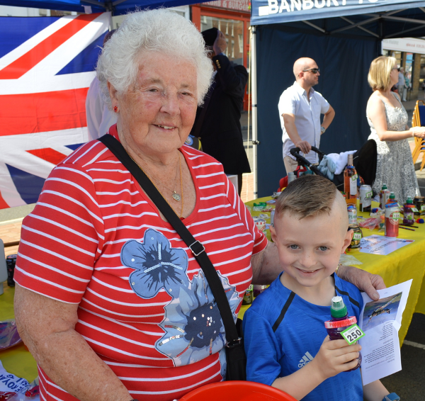 Ryan Hodgkiss with his prize at the Royal British Legion tombola stall with ticket seller Joyce Lake.