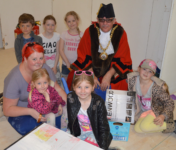 Mayor Tony Mepham joins youngsters at a Banbury and Bicester College 'build a city' project.