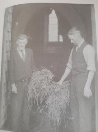 Percy Cook and his brother Sidney Cook, Christopher's relatives strewing the grass at Shenington Church in 1967.