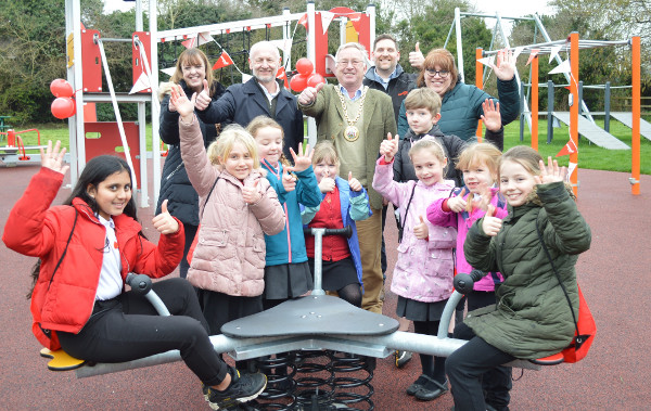 In the picture, town mayor Cllr John Colegrave joins teachers Sarah Moon and Caroline Debus, Steve Sylvester (managing director of equipment manufacturers Kompan), Thomas Griffiths (area sales manager Kompan), and the pupils at the play area opening.