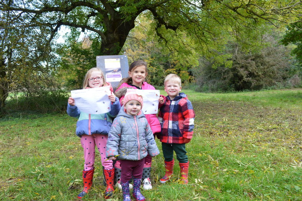 Pictured. Darcey Potter (4), Daisie Potter (1), Ida Higham (5), and Frederick Wise (3) at the start of the new nature trail.