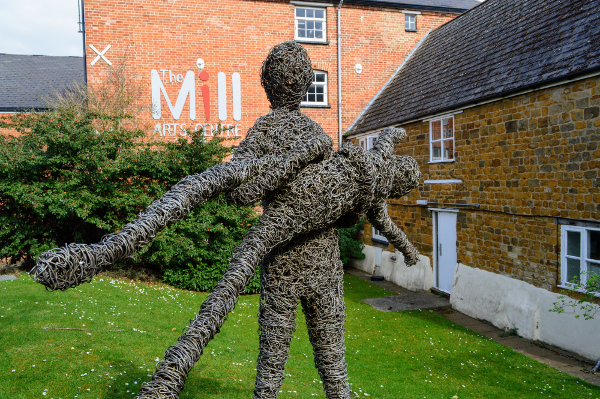 The sculpture is called The Dancers. By students from Learning Disability Classes at The Mill Arts Centre - July 2005