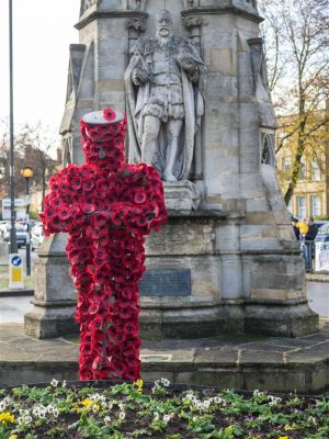 Hundreds show their respects with Banbury's poppy soldier.