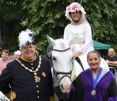 Sir Tony Baldry High Steward of Banbury, Fine lady on a White horse, and deputy mayor Cllr Surinder Dhesi.